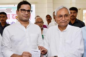 Bihar Chief Minister and Janta Dal United JD(U) National President Nitish Kumar greets electoral strategist Prashant Kishor after he joined JD(U) during party