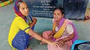 Anil's wife Rani (right) at the Manglapuri crematorium.