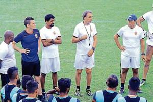 Miguel Portugal (centre) addresses the FC Pune City team during a training session.
