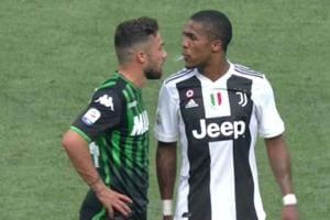 Juventus forwards Douglas Costa caught spitting in the face of Sassuolo's Federico Di Francesco.