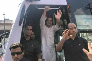 Congress president Rahul Gandhi waves at crowd during a rally in Bhopal on September 17.