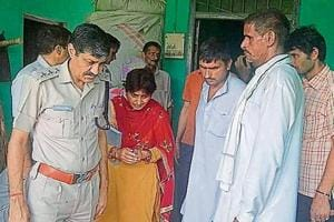 Police and forensic experts collecting evidence from the house of the deceased girl at Behbal village in Rohtak district on Sunday.