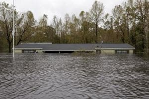 Rising flood waters approach the roof of a home in the aftermath of Hurricane Florence, in Leland, North Carolina, US, on September 16, 2018.