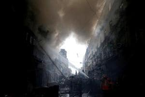 Firefighters try to douse a fire that broke out at a wholesale market in Kolkata, India September 16, 2018.