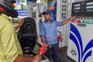 Mumbai: An employee shows the revised prices of petrol and diesel to a customer at a fuel station, as the fuel prices prices continued their record-breaking run, in Mumbai, Friday, September 7, 2018.
