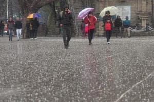 People walking at Ridge during hailstorm in Shimla. The Met department has issued an alert for a hailstorm in Uttarakhand in the next 24-hours, an official said on Monday.