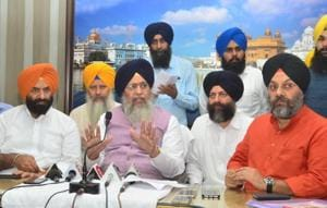 SGPC President Gobind Singh Longowal (3R) along with DSGMC president Manjit Singh GK (R) addressing a press conference at Amritsar.
