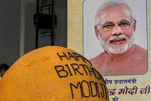 A 568 kg ladoo on display during an event to celebrate Prime Minister Narendra Modi
