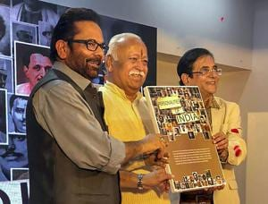 Mohan Bhagwat (centre) and minority affairs minister Mukhtar Abbas Naqvi (left) release a collection of 100 short films