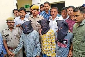 Police with the men arrested on Monday for murder and robbery inMansarovar area of Jaipur.