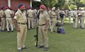Police personnel being assigned their duties for Panchayat Elections at GNPS school Sarabha Nagar in Ludhiana.