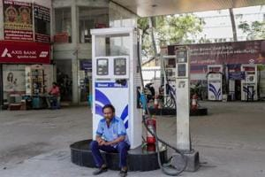 A security person guards at a petrol pump closed during the Bharat Bandh called against fuel price hike, in Coimbatore on September 10.