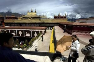 Tourists visit the Jokhang Monastery, one of the oldest Tibetan monasteries in Lhasa in the Tibet Autonomous Region.