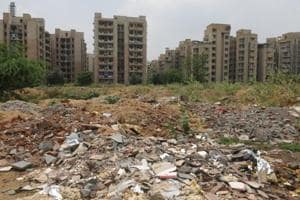 People dumped the construction and demolition (C&D) waste and garbage at a vacant plot near Rail Vihar, at sector-56 road, in Gurugram, India.