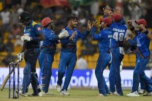 Afghanistan players celebrate the fall of a Sri Lanka wicket in Abu Dhabi on Monday.