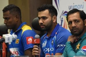 Indian cricket team captain Rohit Sharma (C) speaks during an Asia Cup press conference as Sri Lankan cricket team captain Angelo Mathews (L) and Pakistan cricket captain Sarfraz Ahmed (R) look on at the Dubai International Cricket Stadium in Dubai on September 14, 2018, ahead of the start of the 2018 Asia Cup cricket tournament.