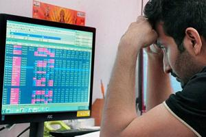 A broker reacts to the crash at the BSE Sensex.