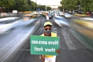 Civil Defence personnel promote odd-even trail at ITO in New Delhi, India.