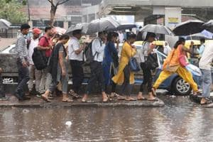 Commuters shelter under umbrellas as they walk through a water logged street during rain at Kashmiri gate in New Delhi, India, on Wednesday, September 05, 2018.