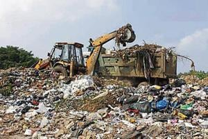Udyog Vihar factory owners say Ecogreen's garbage collection site on Delhi-Gurugram border remains choked.