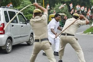 "Congress activists said they were brutally cane-charged at the behest of the minister for protesting peacefully against him after he had allegedly referred to Congress as ""garbage""."