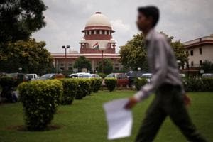 A man walks inside the premises of the Supreme Court in New Delhi, India, July 17, 2018.