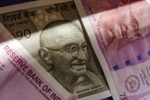Two thousand and five hundred rupee banknotes are arranged for a photograph in Mumbai on January 30.