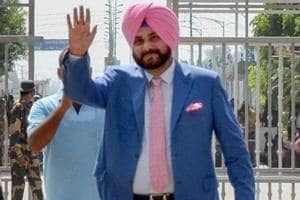 Punjab cabinet minister and former cricketer Navjot Singh Sidhu waves as he crosses the border to attend the swearing-in ceremony of Pakistan Prime Minister-elect Imran Khan, at Attari-Wagah border in Attari on August 17, 2018.