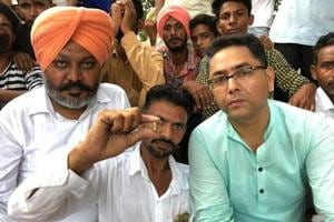 An Aam Aadmi Party worker showing a bullet shell as leader of opposition Harpal Singh Cheema and party's state co­president Aman Arora look on in Sangrur on Wednesday.