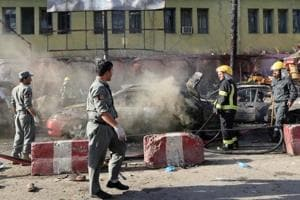 Afghan policemen inspect the site of a blast in Jalalabad city, Afghanistan on July 1.