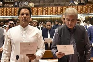 Newly elected parliamentarian Imran Khan (left) takes the oath of office with Shah Mehmood Qureshi, in Islamabad, Pakistan, on August 13, 2018.