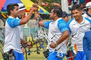 Indian archers Rajat Chauhan, Aman Saini and Abhishek Verma celebrate after winning the Silver medal in men