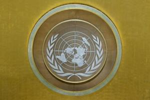 The United Nations emblem is seen in the UN General Assembly hall during the 72nd United Nations General Assembly at UN headquarters in New York on September 22, 2017.