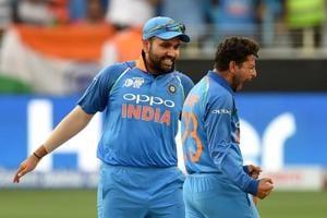 India skipper Rohit Sharma (left) and Kuldeep Yadav celebrate the fall of a Pakistan wicket in Dubai on Wednesday.