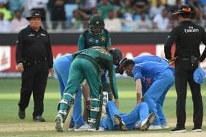 India all-rounder Hardik Pandya lies on his back after getting injured during the Asia Cup game against Pakistan in Dubai.