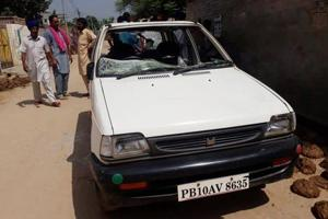 A car damaged in violence at Dullewala village in Bathinda on Wednesday.