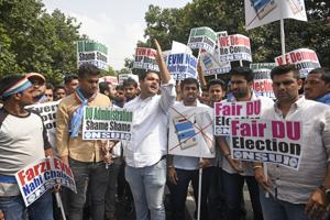 Members of National Students' Union of India (NSUI) stage a protest outside Election Commission in New Delhi.