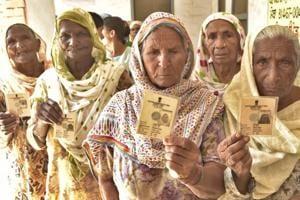 Voters at village Rakba of Mullanpur Dakha during block samiti and zila parishad elections near Ludhiana on Wednesday.