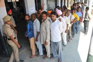 Voters queued outside a polling booth at Bad Majra village in Mohali on Wednesday.