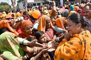 Chief minister Vasundhara Raje interacts with people during the Gaurav Yatra in Dausa district on Thursday.