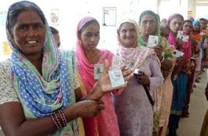 Female voters waiting in cue to cast their votes in zila parishad and block samiti polls at Lambi in Muktsar.