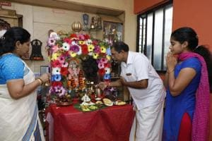 The Nair family start Ganesh puja with the traditional Malayali suprabtham (morning) puja.