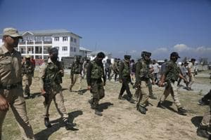 Police officers arrive to pay respect to their colleagues killed by militants, at a base camp inShopian, about 63 kilometers south of Srinagar, Kashmir, September 21