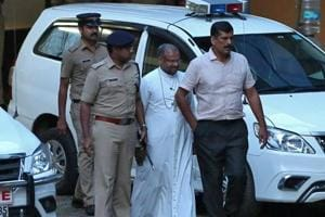 Bishop Franco Mulakkal (2nd right), accused of raping a nun, is pictured outside a crime branch office on the outskirts of Kochi in Kerala.
