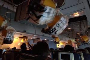Oxygen masks are seen deployed after a loss of cabin pressure, on a Jet Airways flight, from Mumbai, in this still image obtained from social media.