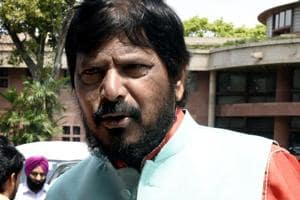 The union government is committed to protect the rights of the SC and ST people, Union minister of state for social justice and empowerment Ramdas Athawale said.
