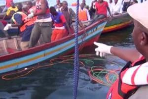 Rescue workers are seen at the scene where a ferry overturned in Lake Victoria, Tanzania September 21, 2018, in this still image taken from video.
