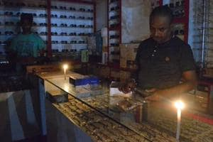 A shopkeeper doing business in candle light in Dhanbad on Wednesday evening, September 21,2018.