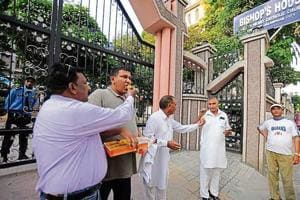 Members of Punjab Christian Movement distributing sweets to each others outside Sacred Heart Catholic Church in Jalandhar on Friday.