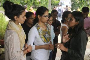 Kanu Priya (left), the recently elected campus president of Punjab University Campus Student Council, interacting with hostellers at the University in Chandigarh.